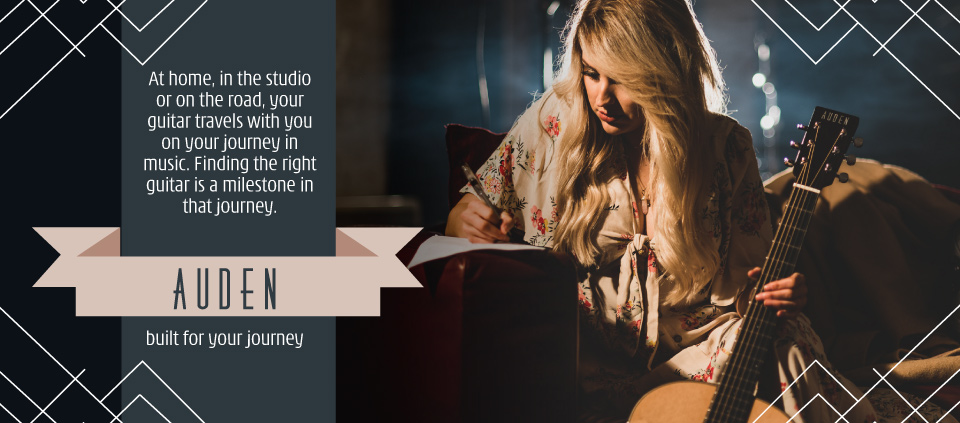 Auden acoustic guitars home page slider image with Carly Loasby writing next to guitar.